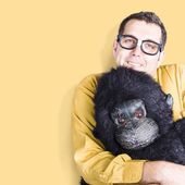Big male goof cuddling toy gorilla. Comfort zone — Stock Photo