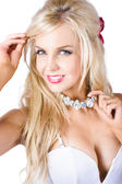 Blond woman with necklace — Stock Photo