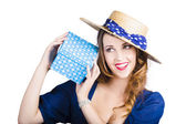 Pin up woman with blue polkadot gift — Stok fotoğraf