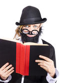Nutty scientific professor reading book — Stock Photo