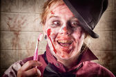 Zombie at dentist holding toothbrush. Tooth decay — Stock Photo