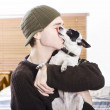 Small dog kissing his male owner. Pet love — Stock Photo