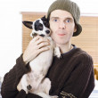 Stock Photo: Young casual lifestyle man with small dog