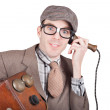 Nerd businessman on a funny phone communication — Stock Photo