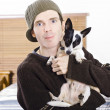 Young man with his little boy dog — Foto de Stock