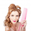 Cute retro female hairdresser with big hair comb — Stock Photo