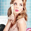 Gorgeous pin-up woman holding large cleaning peg — Stock Photo