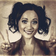 Vintage 50s asian woman showing peace sign on hand — Stock Photo