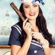 Stock Photo: Smiling young pinup sailor girl. American navy