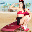 Sexy beach pin up girl wearing high heels — Stock Photo