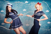 Beautiful navy pinup girls on marine background — Foto Stock