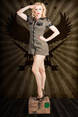 Attractive blond pin-up army girl. Military salute — Stock Photo