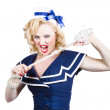Pin up navy girl breaking naval rope with strength — Stock Photo