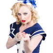 Stock Photo: Strong sailor pin-up model pulling on tough rope