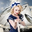 Pinup american military girl pulling sea anchor — Stock Photo