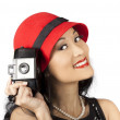 Beautiful Chinese woman holding old film camera — Stockfoto