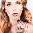 Retro beauty pin up girl applying lipstick makeup — Stock Photo