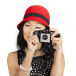 Cute pin up Asian lady taking photo with camera — Stockfoto