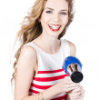 Happy female hairdresser holding hairdryer — Stock Photo