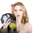 Cold war pin-up woman with gasmask — Stock Photo