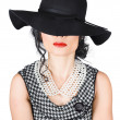 Brunette womin chic pearl jewelry. Fashion hats — Stok Fotoğraf #27783453