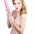 Hair style model. Pinup girl with large pink comb — Stock Photo