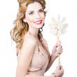 Blonde girl holding windmill fan. Natural energy — Foto de Stock