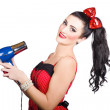 Cute brunette retro woman with hair dryer — Stock Photo