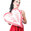 Young lady holding retro red heart card — Stock Photo