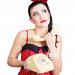 Pinup woman chatting on yellow telephone — Foto de Stock