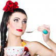 Pin-up woman eating breakfast cereal with spoon — Stock Photo