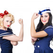 Stock Photo: Pin-up sailor girls showing physical strength