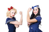 Pin-up sailor girls showing physical strength — Stock Photo