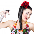 Haircare. Brunette pinup woman using hair product — ストック写真