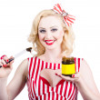 Australian pinup woman holding sandwich spread — Stock Photo