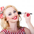 Cosmetics pin-up model applying blusher makeup — Stock Photo
