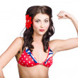 Photo: Pinup girl flexing biceps muscle. Bodybuilding