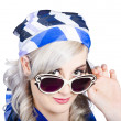 Graceful pin up girl looking over sunglasses — Stock Photo
