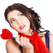 Stock Photo: Beautiful pinup girl holding candy. Sweet heart