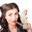 Pinup vintage woman chatting on shoe phone — Stock Photo