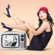 Beautiful asian pin up girl posing on retro tv set — Foto Stock
