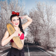 Stock Photo: Pinup skateboarder woman in punk glam fashion