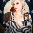 Foto de Stock  : Military pin up womtaking airplane pilot oath