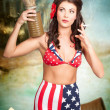 Stock Photo: American danger girl. Pinup beauty on toxic beach