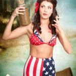 American danger girl. Pinup beauty on toxic beach — Stock Photo
