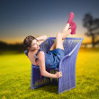 Smiling woman relaxing outdoors looking happy — Stock Photo