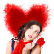 Photo of romantic woman holding heart shape candy — Foto de Stock