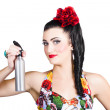 Pinup woman holding a cleaning spray bottle — Stock Photo