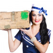 Isolated pin up girl holding a military arms box — Stock Photo