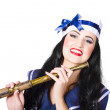 Pinup sailor girl holding telescope — Stockfoto